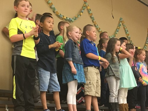 Second Graders perform at the Fall Festival.