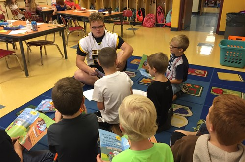 HS Athletes Reading to 2nd Graders